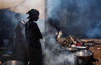 Haitian women cook for others displaced by the earthquake, 2010 ©Ruth Fremson/The New York Times