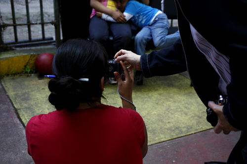 PWP Member Helping a Mother Photograph Her Children