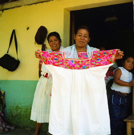 Joaquina Diego displaying her weavings from home, ©Mary Teresa Giancoli