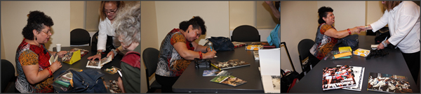 Arlene Gottfried signing books for PWP members in 2009